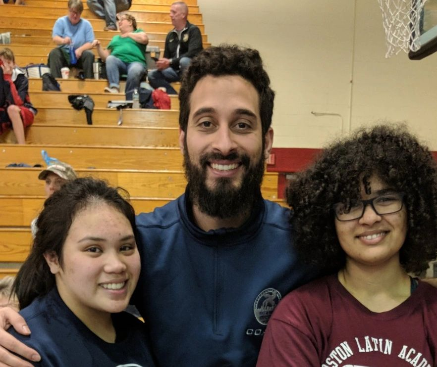 Boston Youth Wrestling founder José Valenzuela poses with two Boston-area wrestlers. As of last week, BYW received official accreditation to become an official Beat the Streets program.